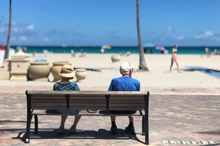 adult beach bench couple depth of field focus leisure miami